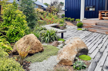 Recycled hardwood boardwalk and native planting